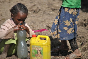 Girl Drinking dirty water from river