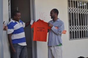 Berhanu receiving Uniforms for Mulat Knowledge School